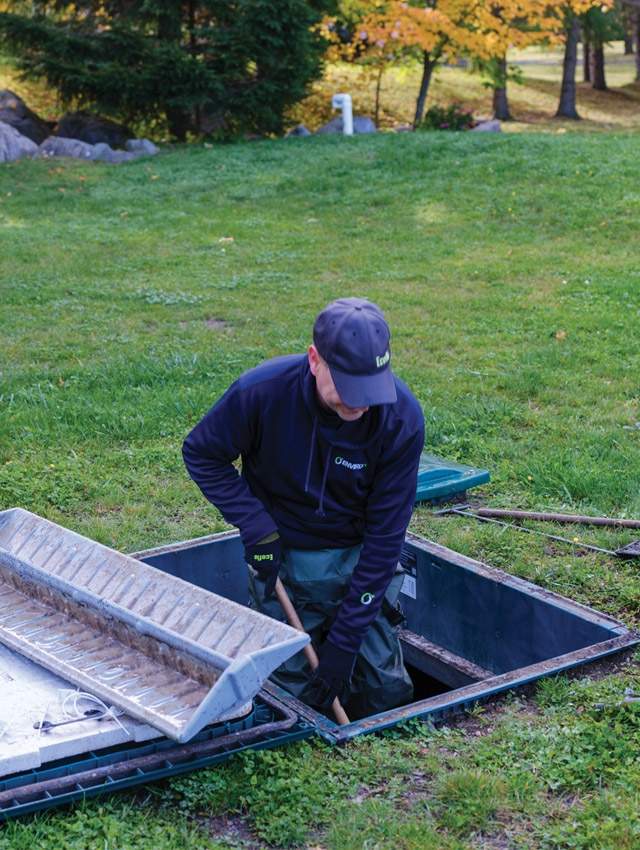 man doing ecoflo green septic system maintenance and inspection